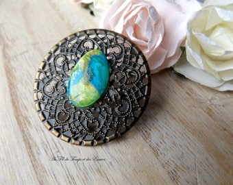 Brooch Print round with pearl drop peacock