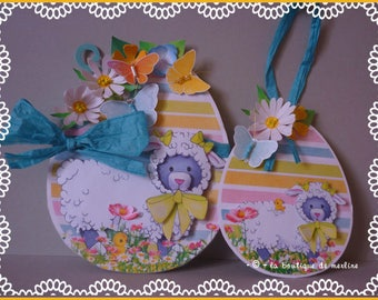 Easter card: card 3D, large egg decorated with flowers, butterfly and sheep