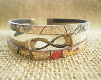 "Bracelet made of suede and faux leather, beige shiny flowers, ""Infinity"" charm"