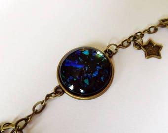Black and light blue/green cabochon bracelet