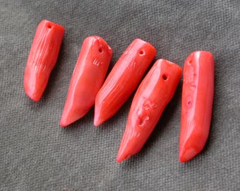 set of 4 coral tooth shaped beads
