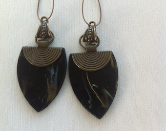 Black, romantic earrings.