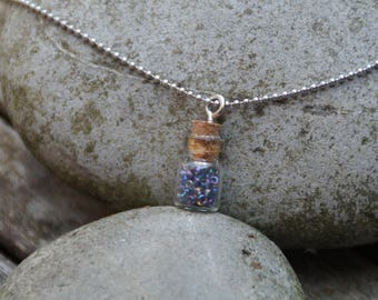 Necklace made with a vial full of seed beads