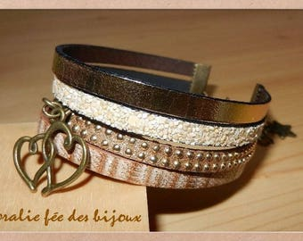 Gold, and printed leather Suede, leather glitter gold hearts and etoile.tons charm Cuff Bracelet