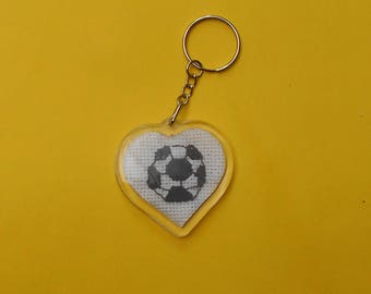 Heart shaped key chain with a football