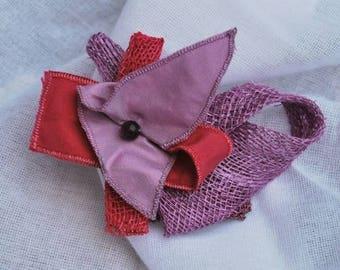 purple-pink brooch necklace