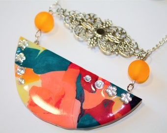 Colored with pearls and Rhinestones, resin necklace made very sparkly