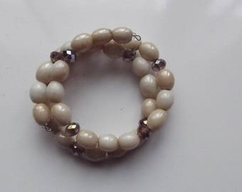 Bracelet on memory wire form with glass pearl beads