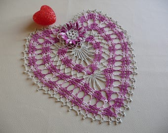 Handmade purple gradient pink cotton and linen crochet lace doily heart for decoration.