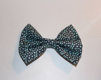 Navy dotted bow