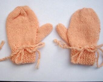 orange acrylic baby mittens