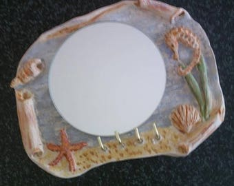 Mirror and key hanging on the theme of the sea clay