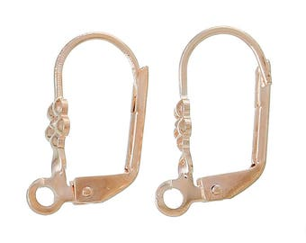 A pair of lever back earrings gold pink.