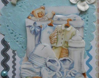 C266 postcard 3D card for a baby boy Bodysuit, bottle, booties, vest, hat and a teddy bear.
