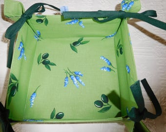 Square basket has bread or empty Pocket tie with link through olives pattern.