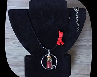 Waxed cotton necklace and its glass phial with microbeads