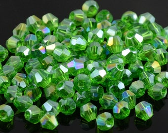 SWAROVSKI Crystal beads AB clear 4 mm - (D65) 10 light green tops