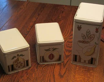 Mid-century modern canisters with fruit designs