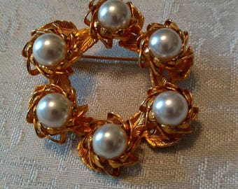 Gold tone pearl brooch