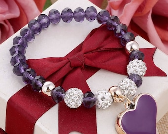 Elastcated purplebead bracelet with heart charm