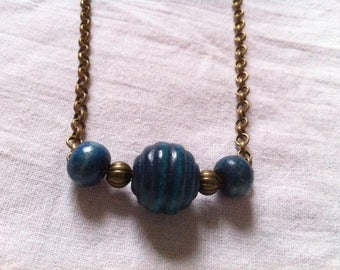 Bronze necklace with blue wooden beads