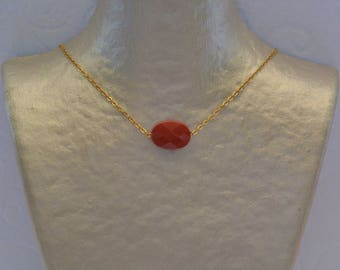 Necklace pillows with brick red and gold chain