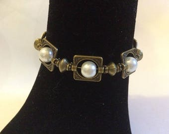 Bronze bracelet with ivory pearls