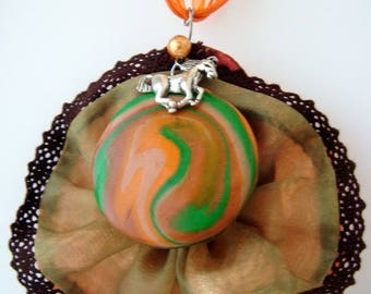 """""""the horse necklace out of the Irish waves""""fimo, fabric and lace, metal horse"""