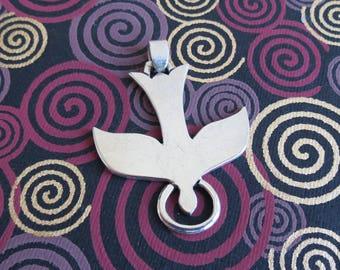 Sweet little sterling silver peace dove pendant