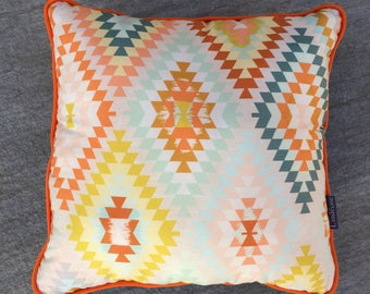 piped cushion 36 * 36 tangy pastel geometric pattern.