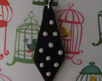 TIE COLLAR HAS POLKA DOT BLACK AND WHITE
