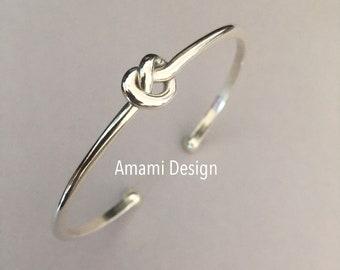 Sterling silver love knot bracelet.