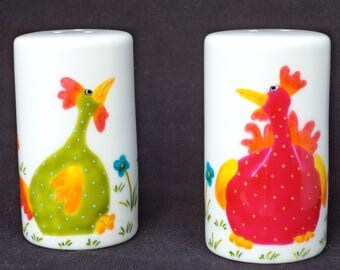 Salt and pepper porcelain. Chick in the Meadow scene.