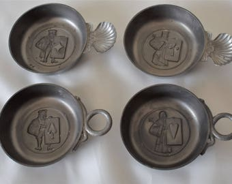 Set of four vintage French tastevins with card suit motifs