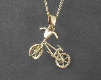 Bmx bike pendant yellow gold 750/1000