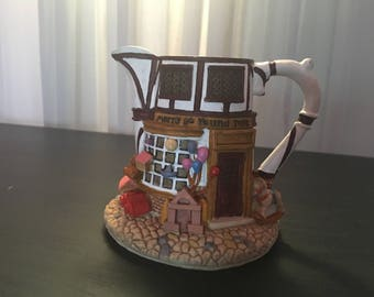 """Hometown Teapot Cottages """"Merry Go Round Toys"""""""