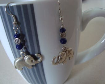 Blue dangle earrings with a silver elephant