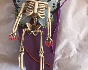Skeleton fairy coffin art