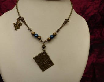 alice in Wonderland reversible blue necklace