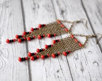 Long earrings red and black.