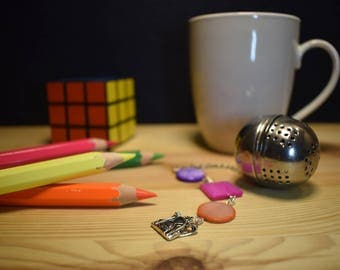 Infuse tea/herbal teas with backpack and beading pendant