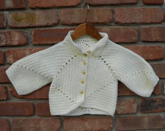 Hand crochet baby sweater with vintage buttons