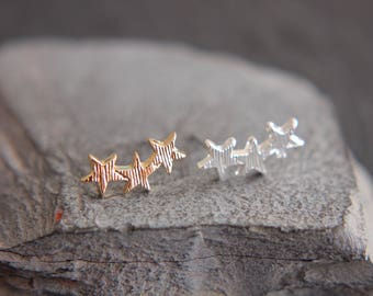 Star earrings in silver, gold
