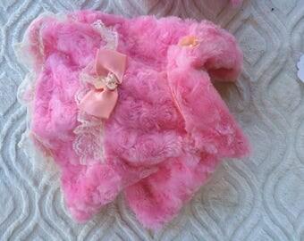 pink fuax fur coat.