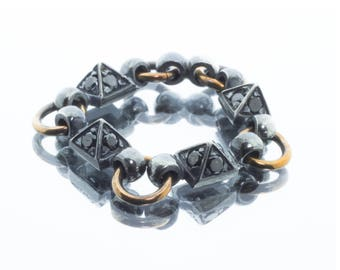 Pyramids ring in oxidized silver and bronze with black diamonds