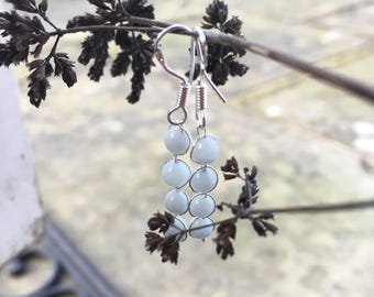 The 'llyria' Handcrafted semi precious light blue natural aquamarine and silver hook earrings.