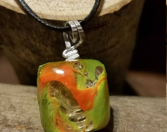 Orange and green colored pendant necklace