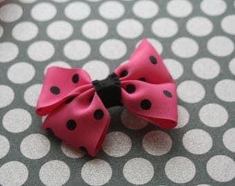 Pink bow black polka dots