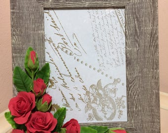 Photo frame decorated with flowers