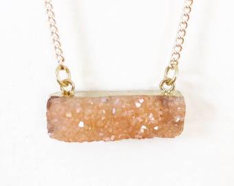 Peach waist length crystal necklace